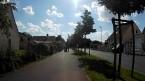 Changement de trottoir, sur lequel circulent 2 personnes.